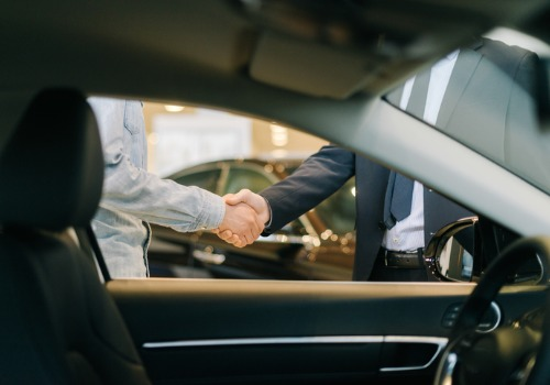 Two Men Shaking Hands Over a Dealership Video Marketing Agreement